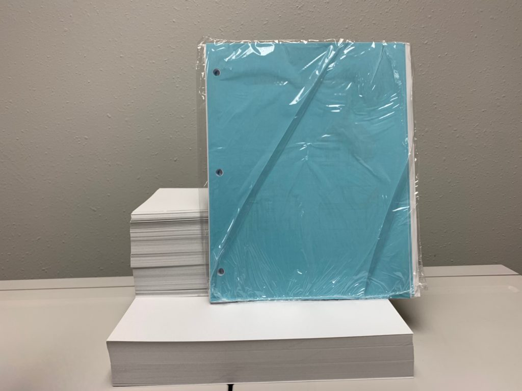 Shrink Wrapped Three-Hole Drilled Booklet